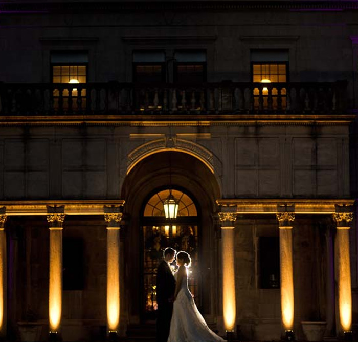 Bride & groomoutside the Archmere Academy