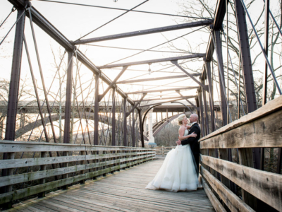 Bride and groom on the bridge at Phoenixville Foundry during the day