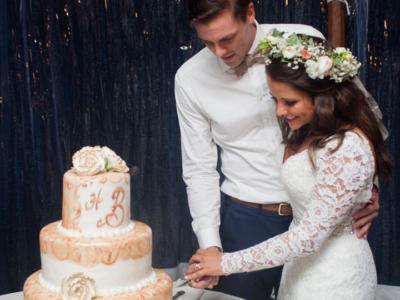 Bride & groom cutting their wedding cake
