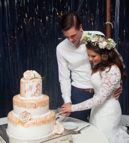 Bride & groom cutting their wedding cake