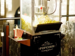 Popcorn machine at an event by Queen of Hearts Catering
