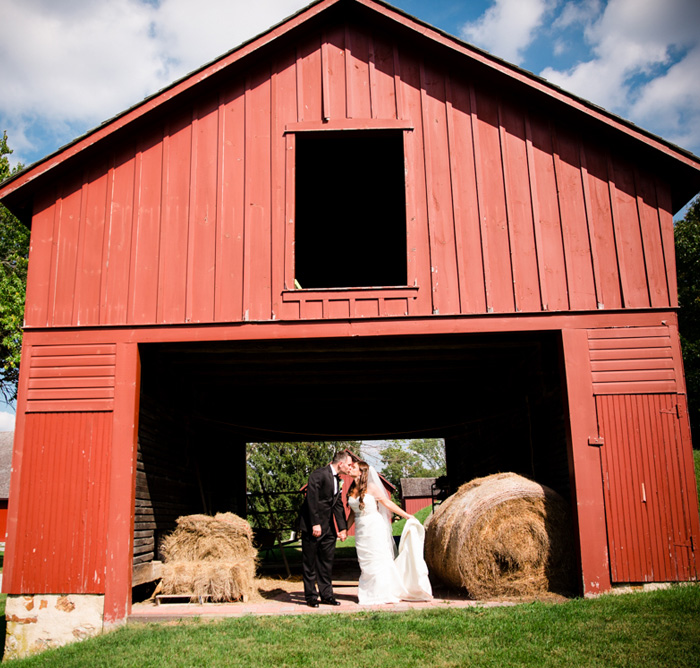 Bride & Groom in the red barn at Springton Manor Farms