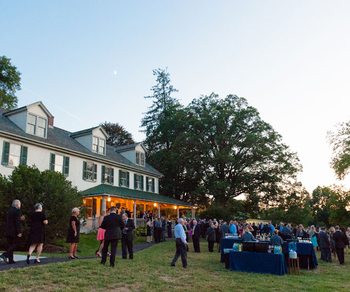 Outdoor cocktail hour by Queen of Hearts Catering