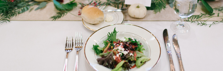 Plated salad at a holiday party by Queen of Hearts Catering