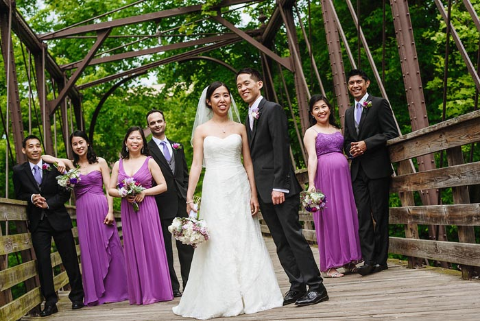 Newlyweds Melinda and Dustin Chang with their wedding party at Phoenixville Foundry.