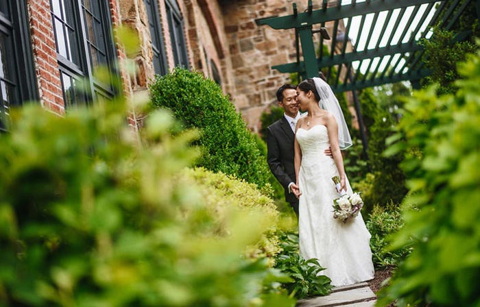 Newlyweds Melinda and Dustin Chang at their Phoenixville Foundry wedding
