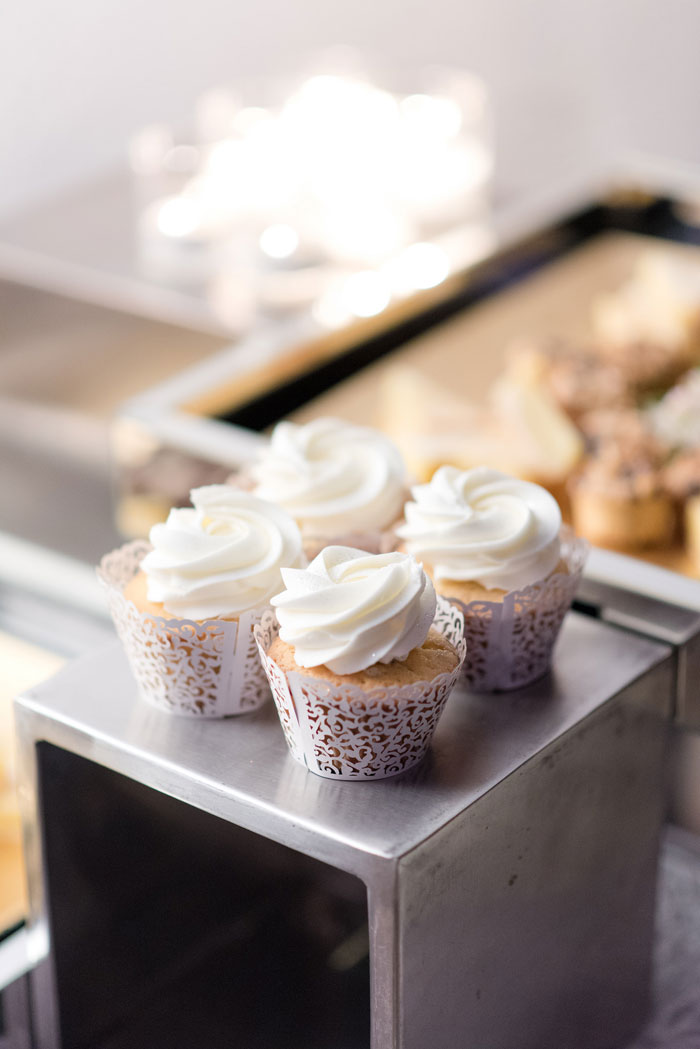 cupcakes beautifully wrapped in delicate doilies