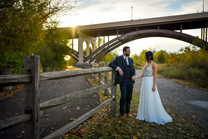 Bride and Groom Take Pictures by Bridge at Phoenixville Foundry
