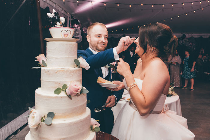 Bride and Groom Cut Cake at Wedding Ceremony
