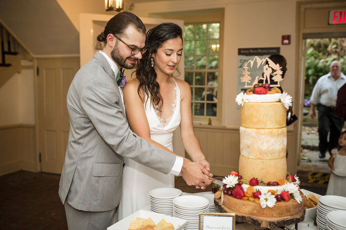 Bride and Groom Cut Cheese Wedding Cake