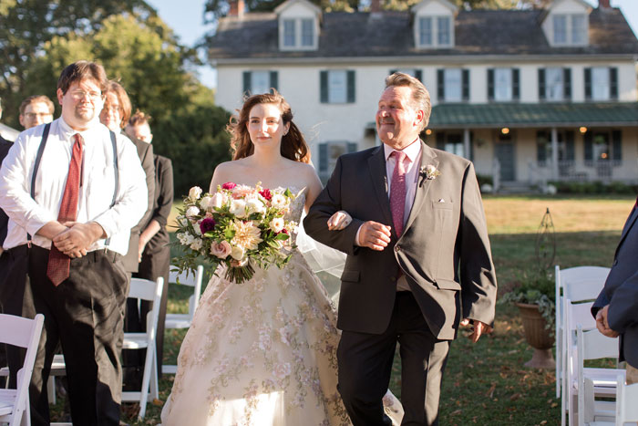 Bride Walks Down Aisle with Father at Outdoor Wedding
