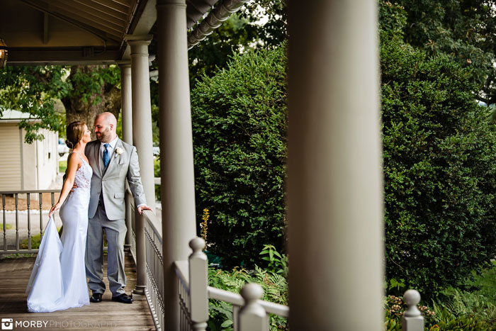 Bride and Groom Pose on the Porch of Springton Manor